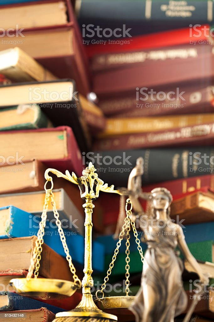 Law concept, statue and books stock photo