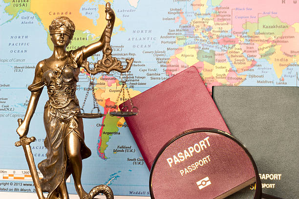 Law concept, statue, magnifying glass, passport and world map. Travel – Foto