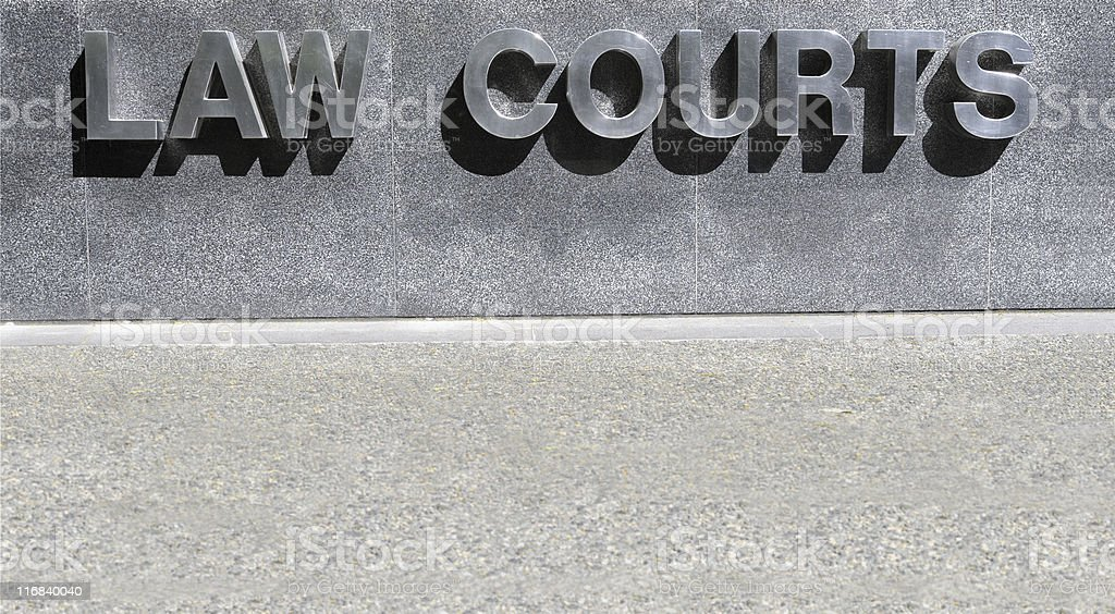 Law Courts sign in stainless steel royalty-free stock photo