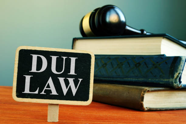 DUI law driving under the influence sign and books. stock photo