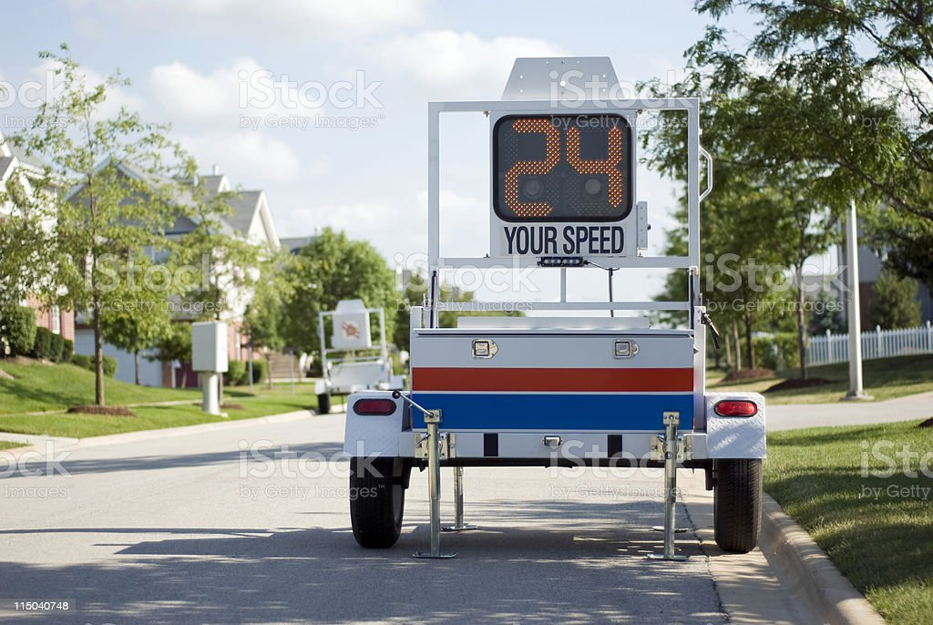 Law Enforcement Mobile Police Speed Radar Trailer Sign on Street royalty-free stock photo