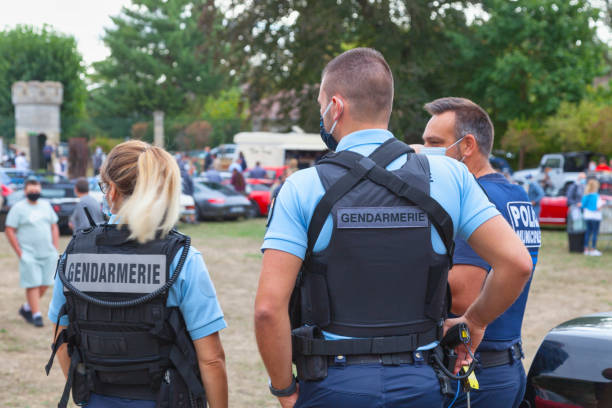 Law enforcers making sure that visitors are wearing their masks during a car show stock photo