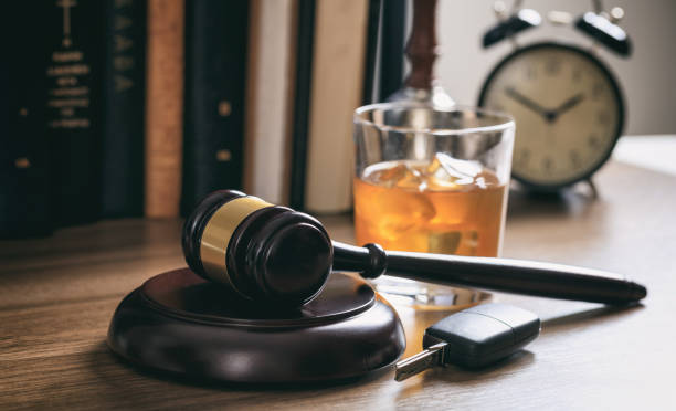 Law gavel, alcohol and car keys stock photo