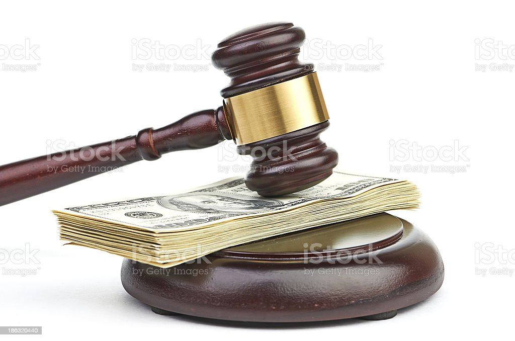Law gavel on a stack of American money. royalty-free stock photo