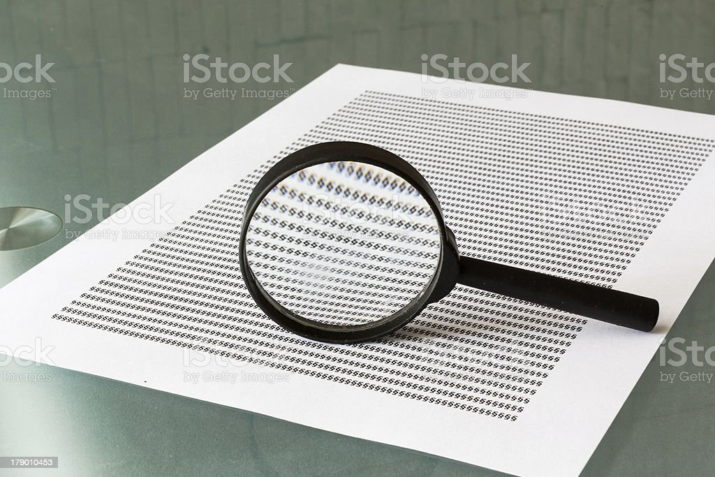 Law investigation, magnifying glass with document royalty-free stock photo