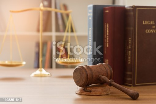 Law, Legal Concept. Judge gavel with law book, scales of justice in courtroom.
