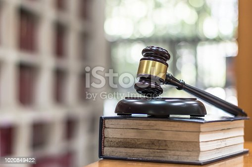 istock Law, legal judgement, litigation and justice concept with judge gavel on law textbook in library archive study room 1020849422