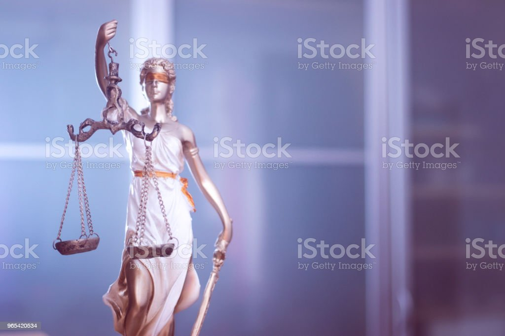 Law office legal justice statue of blind goddess Themis with scales in lawyers office. stock photo