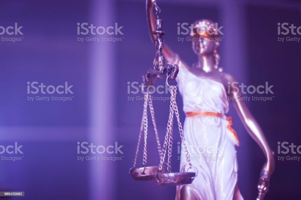 Law office legal justice statue of blind goddess Themis with scales in lawyers office. royalty-free stock photo