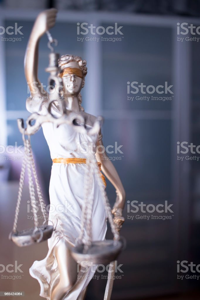 Law office legal justice statue of blind goddess Themis with scales in lawyers office. zbiór zdjęć royalty-free