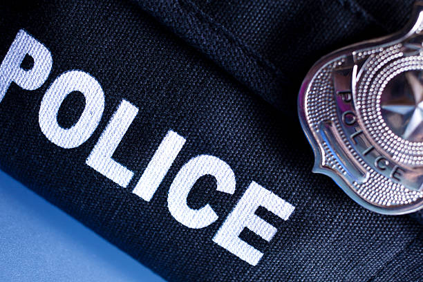Law: Police bulletproof vest and badge. Policeman's bulletproof vest and badge. police uniform stock pictures, royalty-free photos & images