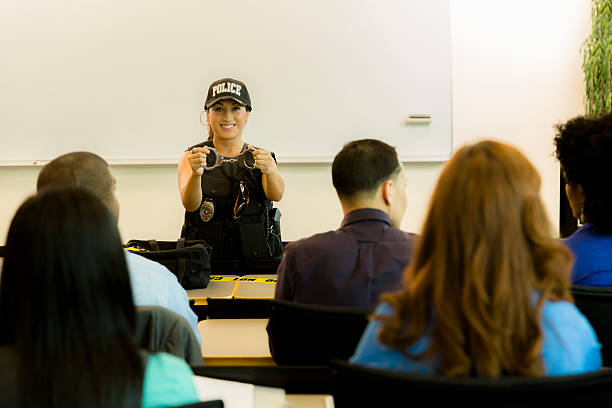 Law:  Policewoman speaks to police cadets or community. stock photo