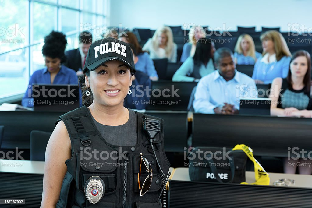 Law:  Policewoman speaks to police cadets. royalty-free stock photo