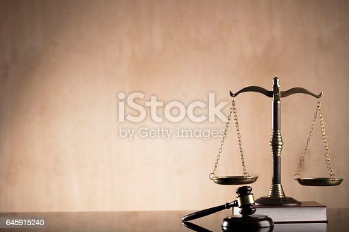 istock Law. Scales of justice, books, gavel 645915240