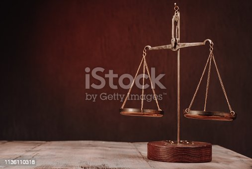 Law scales on table. Symbol of justice - Image