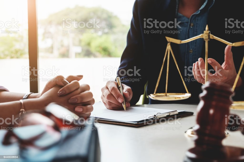 Law should know concept, The lawyer explained to the client to plan the case in court. stock photo