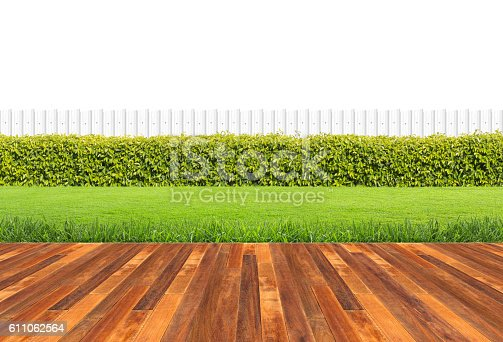 istock Lawn and wooden floor with hedge 611062564