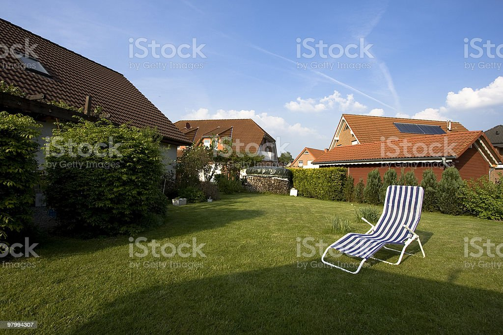 Lawn behind the house royalty free stockfoto