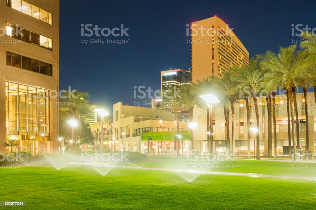 Lawn being watered in park in downtown Phoenix Arizona USA stock photo