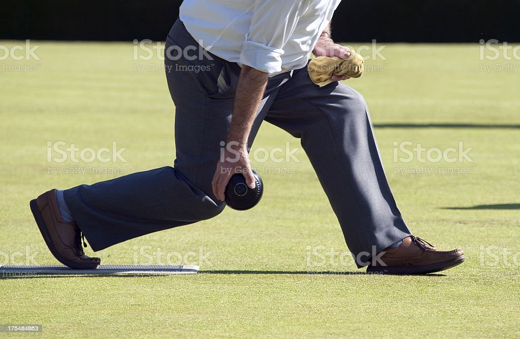 Lawn Bowler in Action stock photo