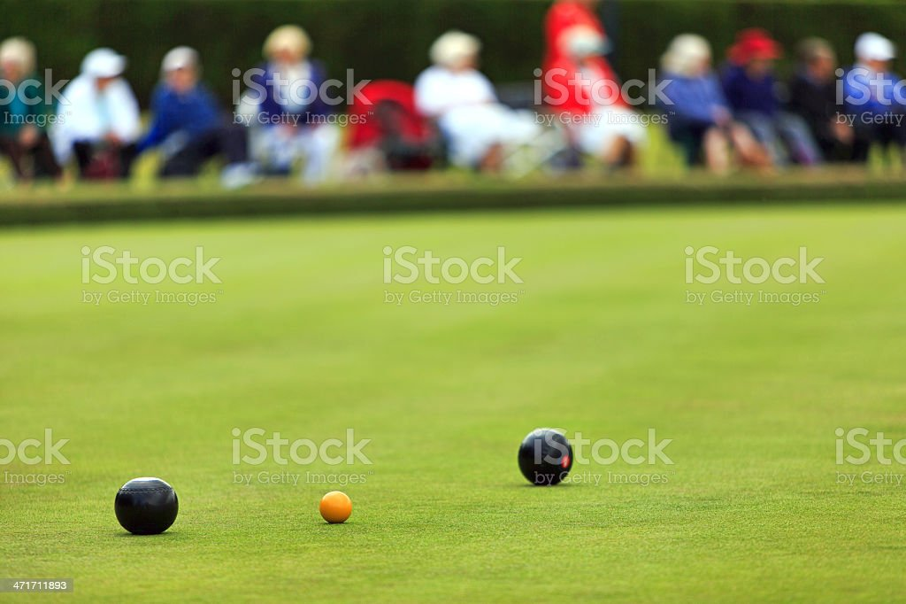 Lawn bowls match with distant spectators stock photo