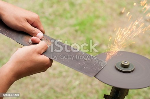 istock Lawn mower blade sharpening. 486332999