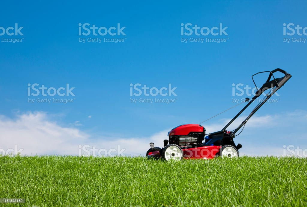 Lawn Mower in the Grass royalty-free stock photo
