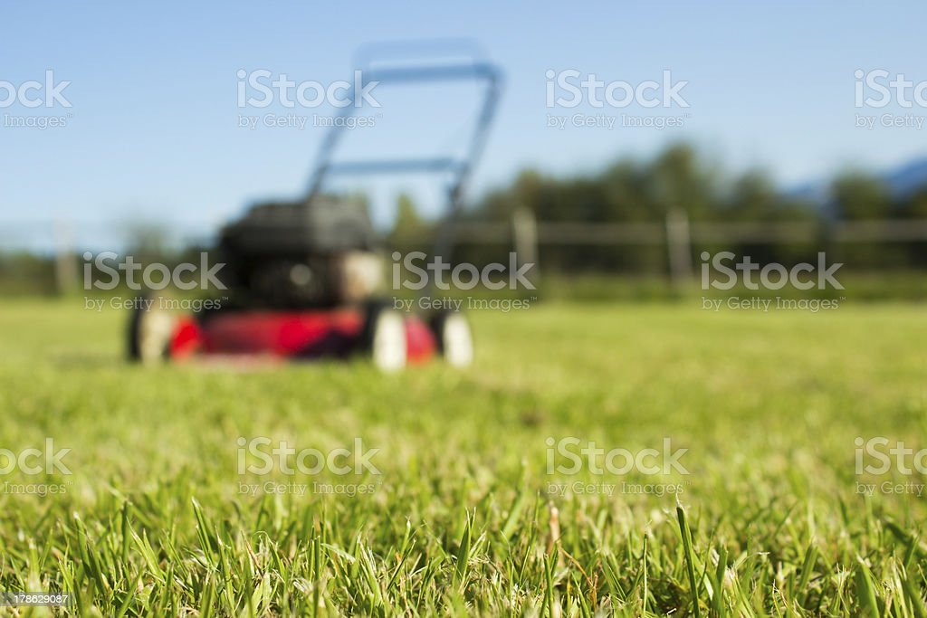 Lawn mower on grass stock photo