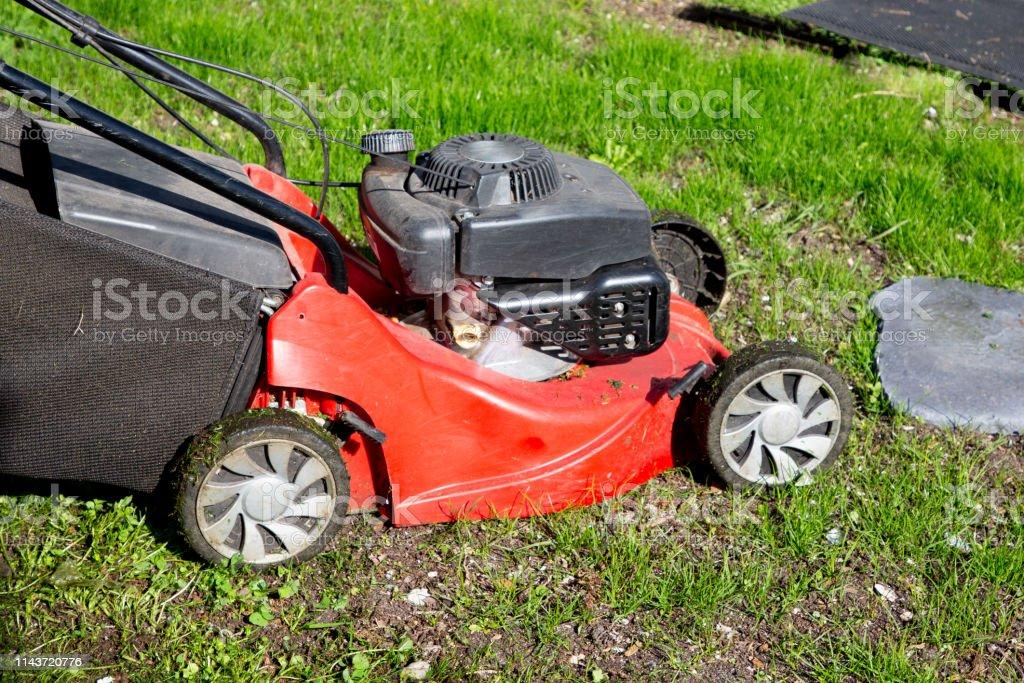 Lawn mower on green grass equipment mowing gardener care work tool