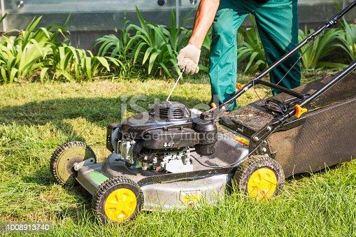 istock Lawn mower starting 1008913740