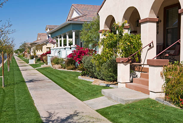 Lawn mowing day in planned community stock photo
