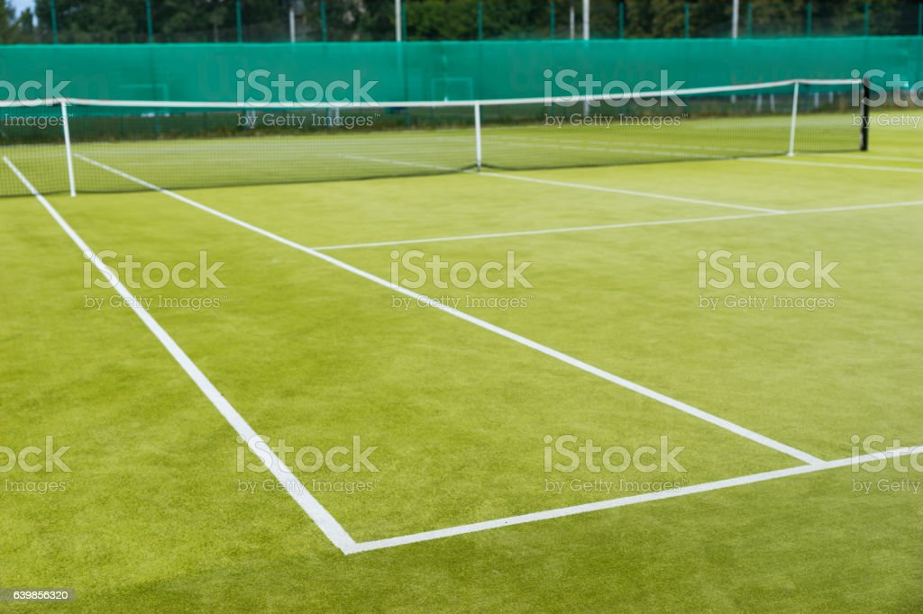 Lawn tennis court and net stock photo