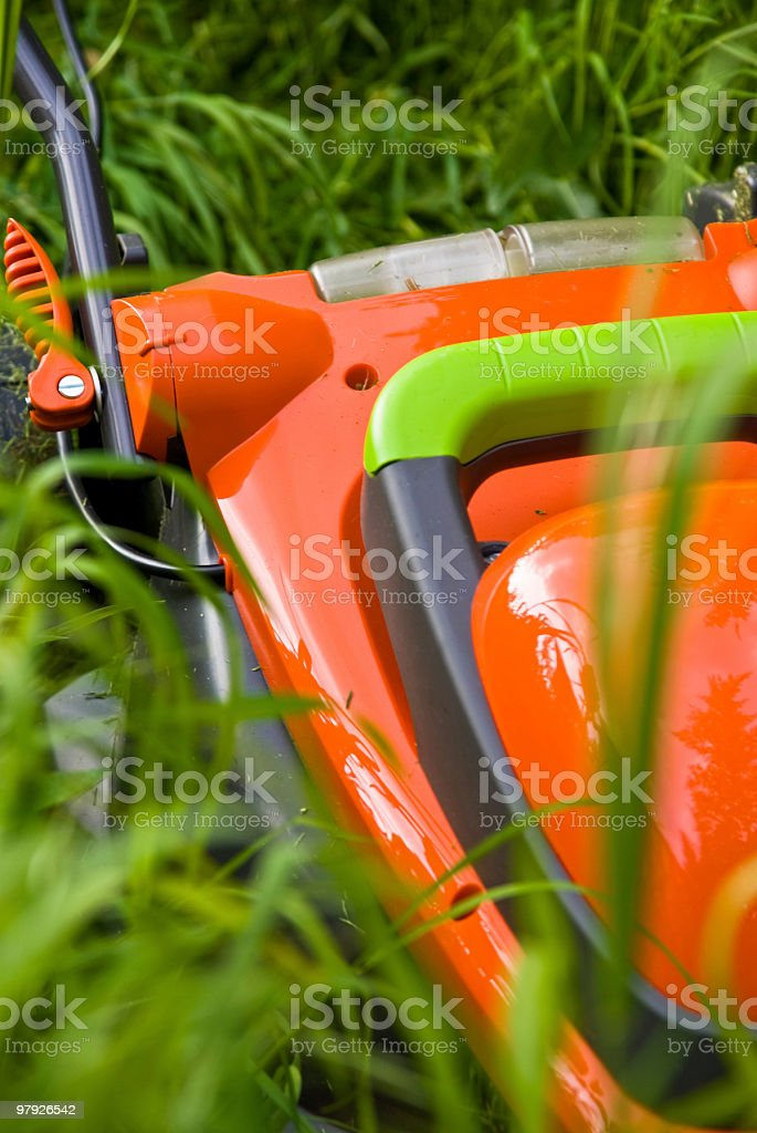 Lawnmowner in long grass royalty-free stock photo