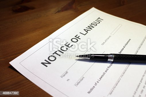 Someone filling out Notice of Lawsuit Form.