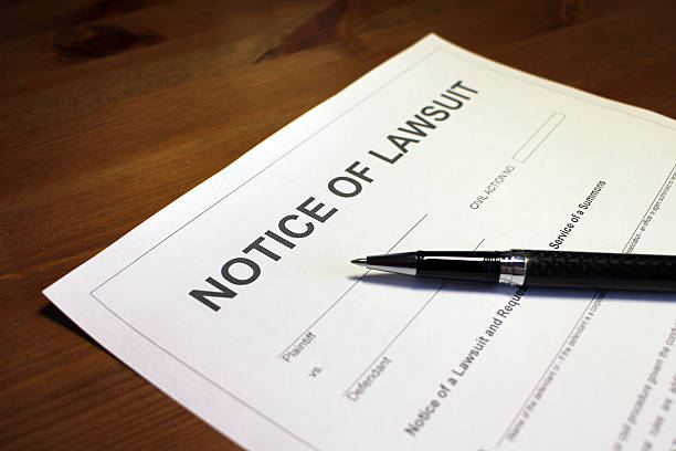 Lawsuit Document Someone filling out Notice of Lawsuit Form. lawsuit stock pictures, royalty-free photos & images