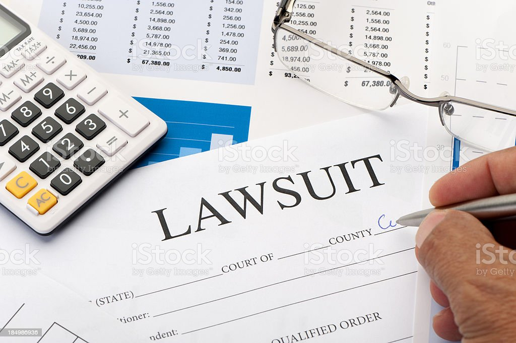 Lawsuit form an a desk royalty-free stock photo