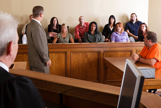 Lawyer Addressing the Jury A lawyer in a courtroom talking to the jury. legal trial stock pictures, royalty-free photos & images