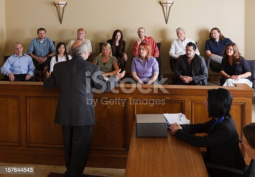 A lawyer in a courtroom talking to the jury.