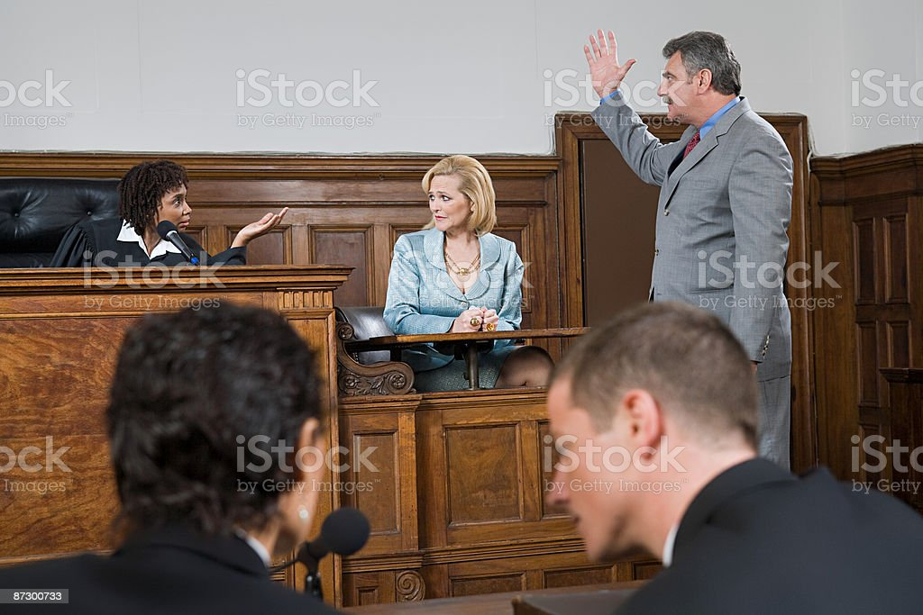 A lawyer and a judge arguing stock photo