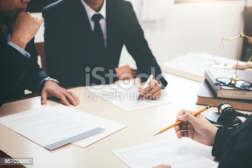 istock Lawyer and attorney having team meeting at law firm. 957026892