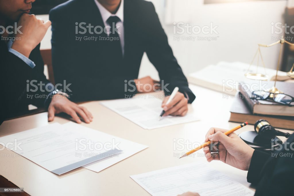Lawyer and attorney having team meeting at law firm. stock photo