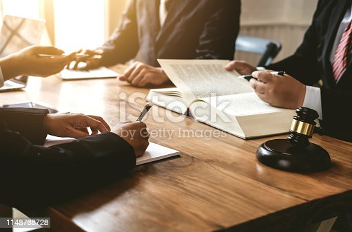 istock Lawyer and businessman consultation and signed the agreement treaty. 1148788728