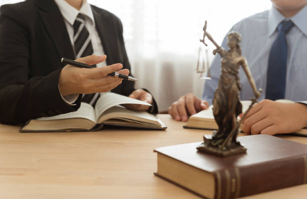 lawyer and client Law, Legal advice, Legislation concept. Lady justice on law book with lawyer and client in law office. practicing stock pictures, royalty-free photos & images