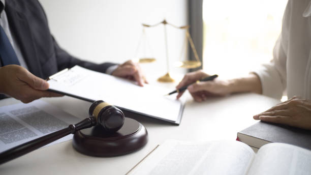 Lawyer and client with legal contract signing in law firm. stock photo