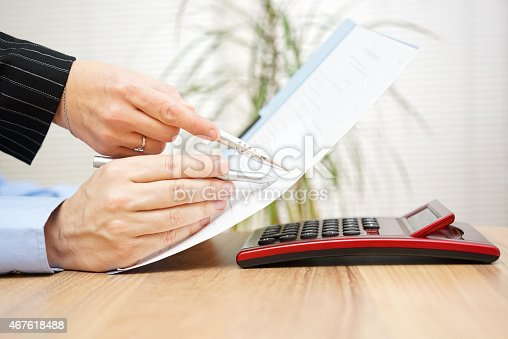 istock Lawyer and his client are examining legal document 467618488