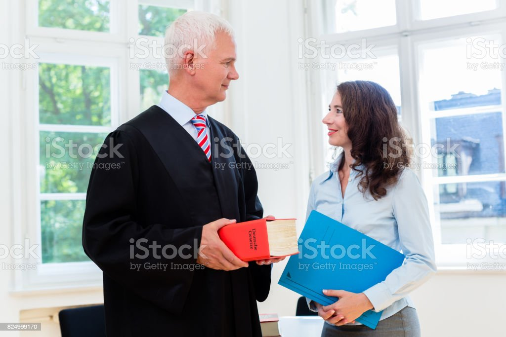 Lawyer and paralegal in their law office stock photo
