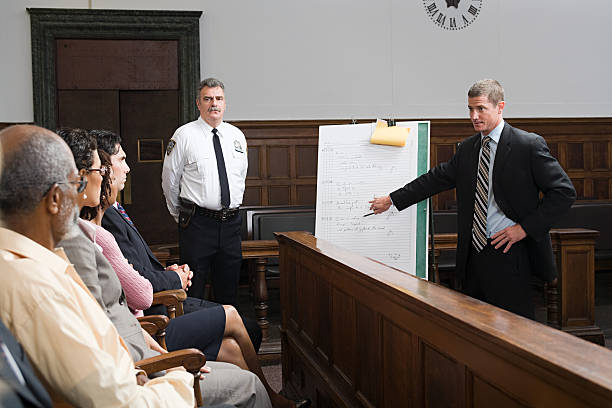 A lawyer and the jury  courtroom stock pictures, royalty-free photos & images