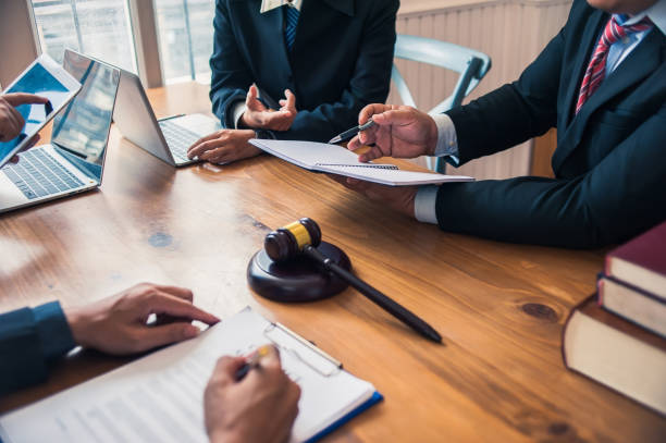 Lawyer are currently providing legal advice to clients.Legal planning Lawyer are currently providing legal advice to clients.Legal planning auction stock pictures, royalty-free photos & images