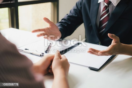istock Lawyer are providing legal advice to clients. 1050558778