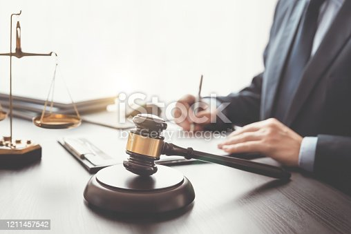Lawyer, attorney with gavel working in the office. Legal, law concept